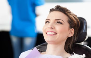 Woman in Dentist Smiling After Full Mouth Reconstruction Alpharetta GA