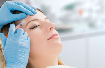 Woman Receiving Botox Injections from Her Dentist Alpharetta, GA