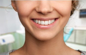 Smiling young woman after Cosmetic Dentistry Treatments in Alpharetta GA